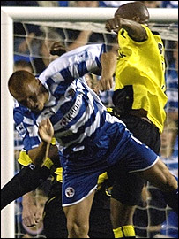 Ousmane Dabo (right) and Steve Sidwell clash at the Madejski Stadium