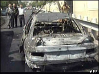 Burned-out vehicle in front of the US embassy in Damascus, from al-Arabiya satellite TV channel