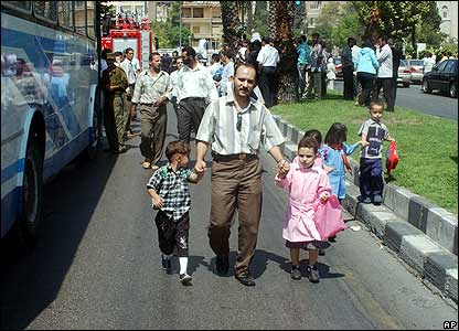 Father collects his children from school near embassy