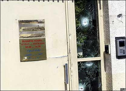 Bullet-holes in embassy windows