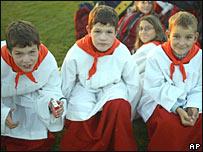 Three altar boys wait in Regensburg for the pope
