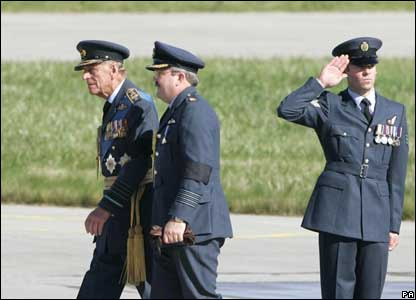 The Duke of Edinburgh (left) arrives at the ceremony, accompanied by Kinloss Station Commander Group Captain Chris Birks.