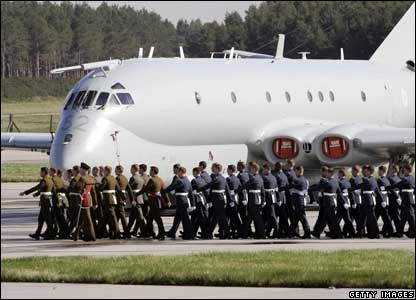 The bearer parties march past a Nimrod at the Moray base.