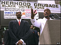 Tupac Shakur, right, speaks alongside Snoop Doggy Dogg during a voter registration rally in Los Angeles