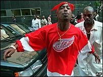 Tupac Shakur spits in the direction of reporters as he leaves state Supreme Court in New York, July 1994