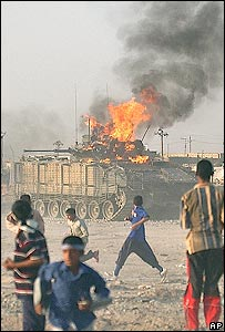 British tank burns in Basra, Iraq, September 2005