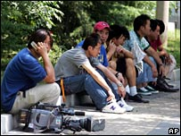 Reporters outside the Beijing court where journalist Ching Cheong was tried in August