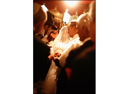 Bride and groom under canopy. Image credit: Contre Jour