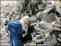 A woman walks amongst rubble in the southern Lebanese town of Bint Jbeil.