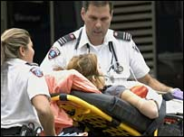 A woman is evacuated during a shooting incident at Dawson College in Montreal, Canada