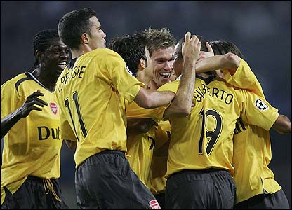Gilberto Silva is congratulated by his Arsenal team-mates