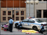 A body lies next to a police car at Dawson College in Montreal