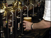 A barman pulling a pint of beer
