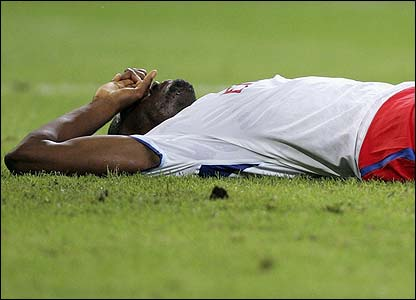 Boubacar Sanogo lies on the pitch after defeat to Arsenal