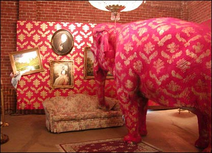 BBC picture of Banksy art in Los Angeles: elephant painted like pink chintz in a pink chintz living room