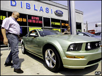 Man checking cars at Ford dealer