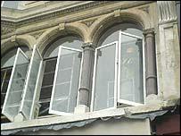 Workman in window