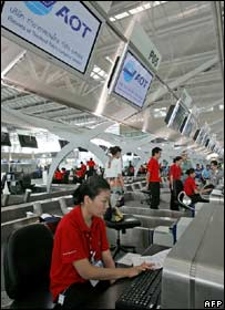 Airport employees test the new check-in desks
