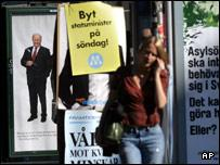 Election posters seen behind a woman in central Stockholm