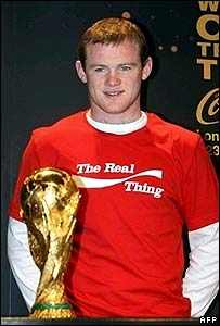 England's Wayne Rooney with the World Cup trophy in March 2006