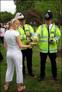Police officers take cakes from the White Rabbit