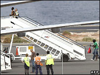 Migrants are led onto a plane to be deported to Senegal from the Canary Islands