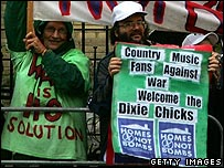 Anti-war protesters wave banners supporting the Dixie Chicks