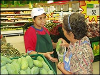 Sales assistant helps Tesco customer in Thailand