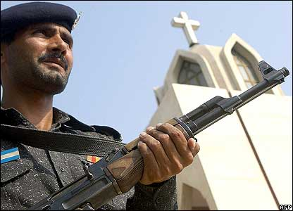 Pakistani policeman stands guard in front of St John's Catholic Church in Peshawar, Pakistan