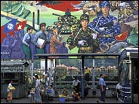 A billboard showing troops at Rangoon's bus station