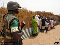 An African Union soldier stands guard in the village of Goes Being in Darfur