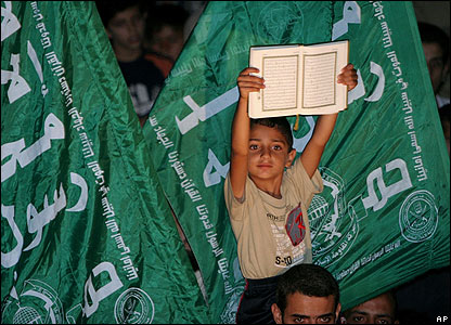 A Palestinian youth holds a copy of the Koran during a protest in Gaza City.