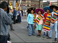 Mexican family in traditional costume on Zocalo Square