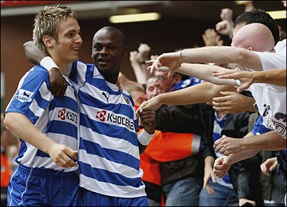 Kevin Doyle celebrates with Leroy Lita