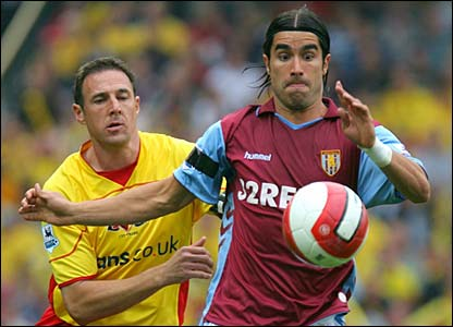 Juan Pablo Angel holds off the challenge of Malky Mackay