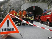 Rescue workers at crash scene outside Viamale tunnel, Switzerland