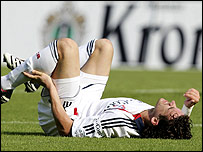 Owen Hargreaves lies on the pitch in agony after being injured playing for Bayern Munich