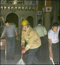 A church in the West Bank city of Nablus is cleaned after firebombing