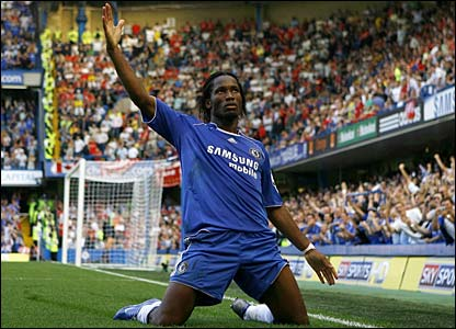 Didier Drogba slides on his knees to celebrate opening the scoring