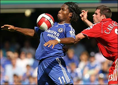 Didier Drogba holds off Jamie Carragher