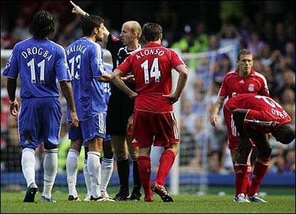 Referee Mike Riley sends Michael Ballack off