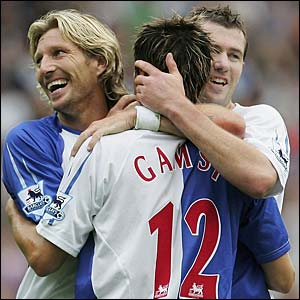Morten Gamst Pedersen is congratulated by Robbie Savage and Brett Emerton