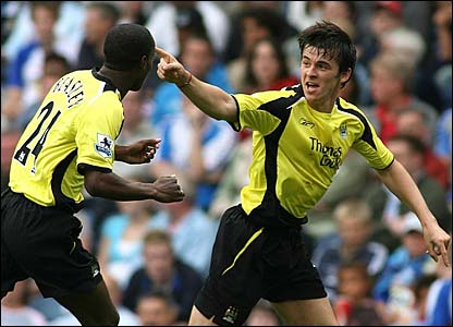 Joey Barton is congratulated by DaMarcus Beasley