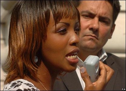 A Rwandan woman outside the Sudanese embassy in London, UK
