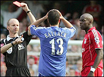 Referee Mike Riley gives Michael Ballack (centre) his marching orders for a challenge on Mohamed Sissoko (right)