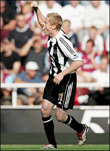 Damian Duff celebrates his first ever goal for Newcastle