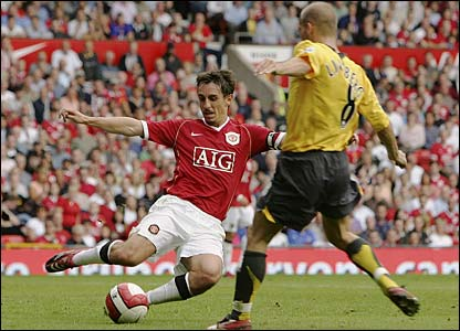 Gary Neville flies into a tackle with Freddie Ljungberg