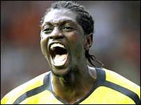 Arsenal striker Emmanuel Adebayor celebrates