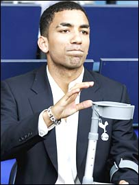 Aaron Lennon watches from the stands