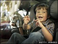 A boy in a child car seat